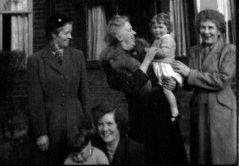 1954, the year of Mildred's retirement. Mildred is holding Kathy (my twin), flanked by Granny Hooke and Great Aunt Ella. In the foreground are my mum, Valerie Hooke and I (Graham).