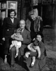 1954: Twins, Kathy and I, securely held by Granny (Elaine) & Grandpa (Cyril) Hooke with Mum (Valerie Hooke) and Mildred.