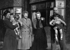 1954: Six Hookes - Granny, Ella, Mildred & Cyril with twins, Kathy & Graham. Grandpa had a sure, but unorthodox grip on me!